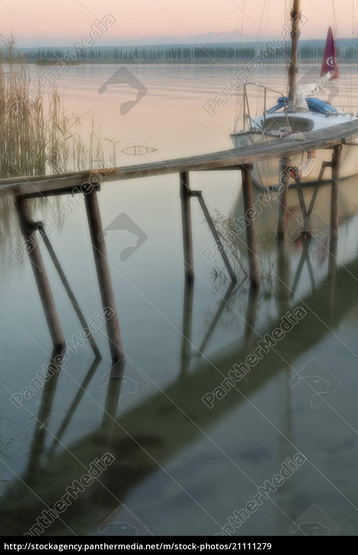 germany, , boat, next, to, jetty, reflecting - 21111279