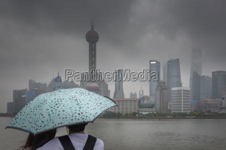 china shanghai chinese couple with umbrella
