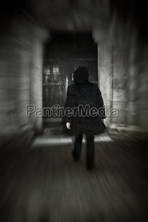 man with hooded jacket walking towards