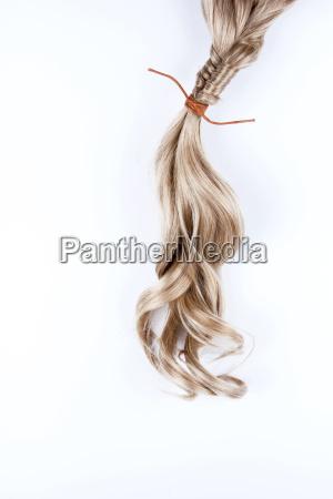 blond braid on white background