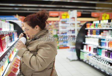 woman in supermarket smelling at bath