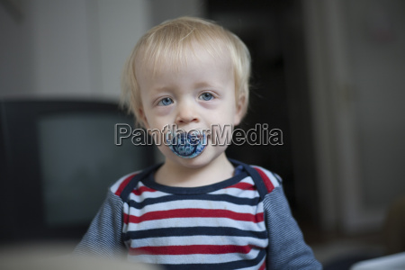 portrait of little boy with pacifier