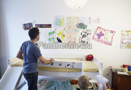 father and son in kids room