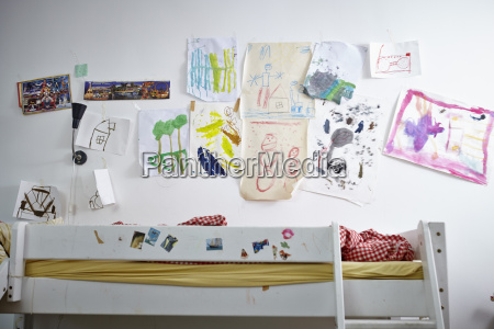 childrens drawings on wall over bunk
