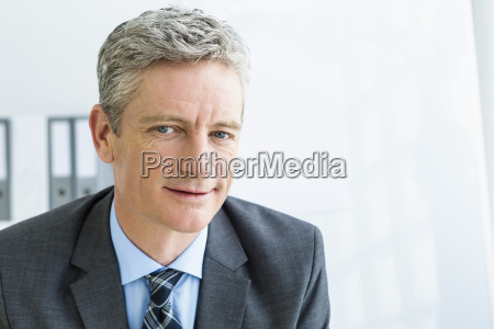 germany portrait of businessman smiling