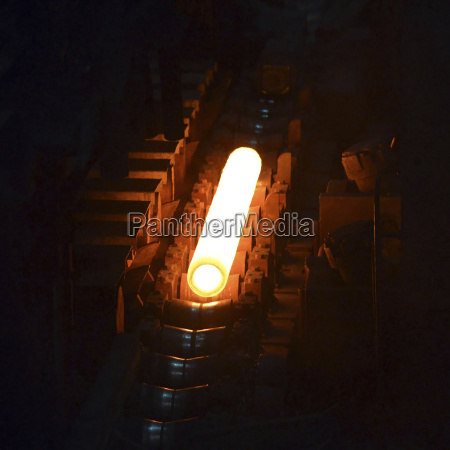 glowing steel pipe in a tube