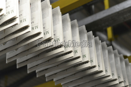 conveyor belt with printed newspapers in