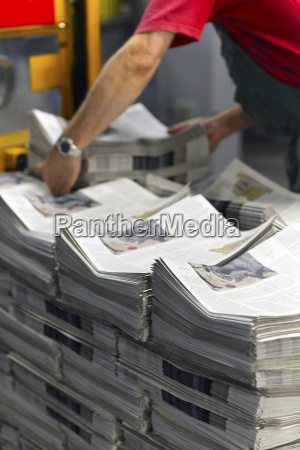 employee in a printing shop preparing