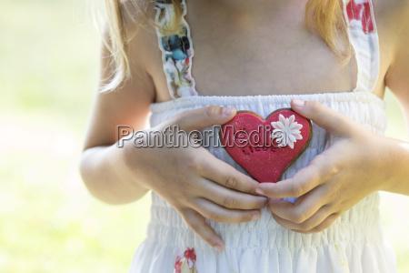 germany bavaria girl holding heart shaped