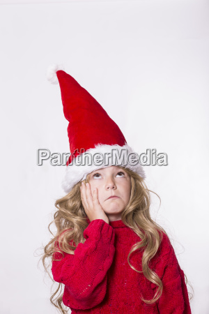 girl wearing santa hat hand on