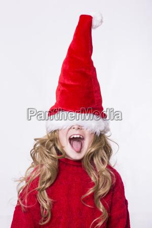 girl wearing santa hat eyes obscured