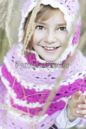 germany vilsbiburg girl wearing poncho portrait