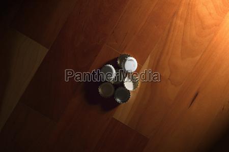 bottle caps on parquet flooring