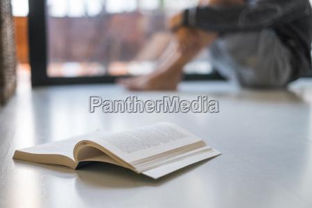 opened book lying on floor