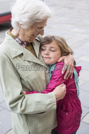 great grandmother and great granddaughter caressing