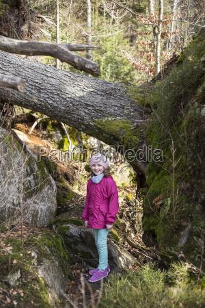 little girl standing besides an upset
