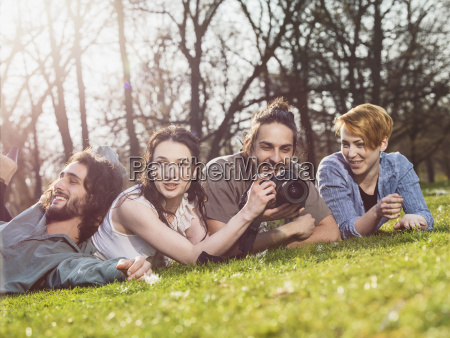 group of four friends relaxing on