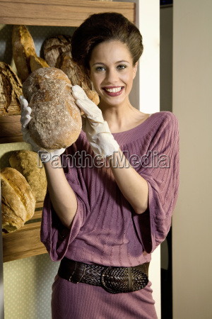 portrait of smiling young woman presenting