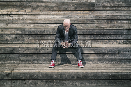 businessman weraing suit and red sneakers