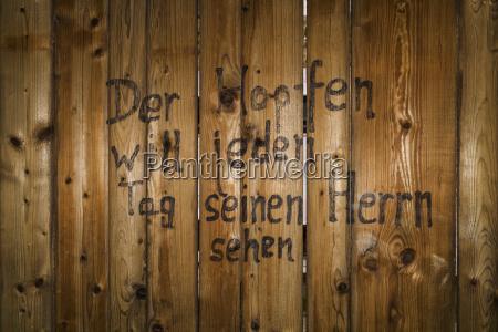 writing at wooden wall