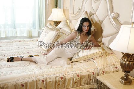 woman wearing fashionable dress lying on
