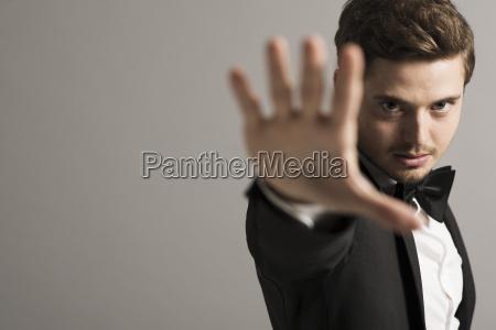 man wearing tuxedo in front of