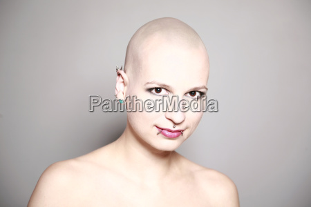 young woman with bald head and