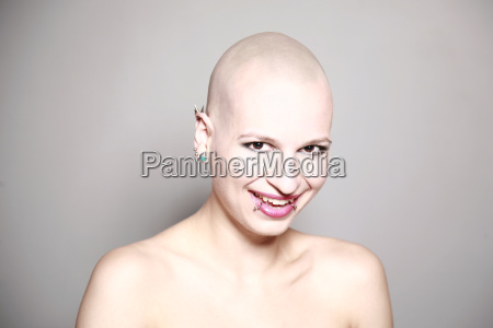 smiling young woman with bald head