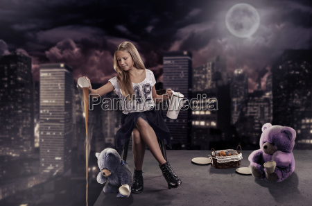 girl sitting on the roof of