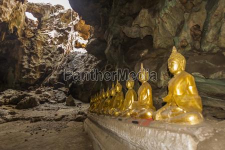 thailand phetchaburi row of golden buddha