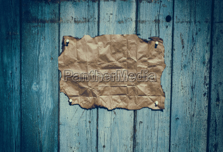 brown rumpled kraft paper hanging on