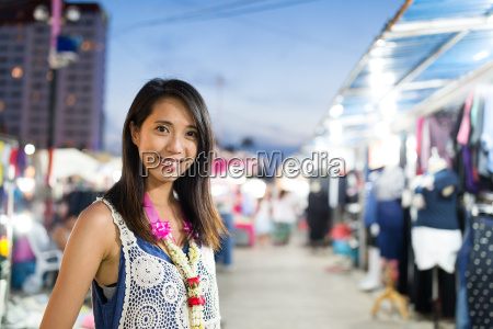 woman shopping at night market in