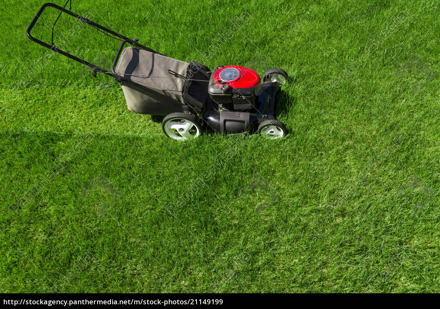 Lawn Mower In The Garden On Green Grass Royalty Free Image 21149199 Panthermedia Stock Agency