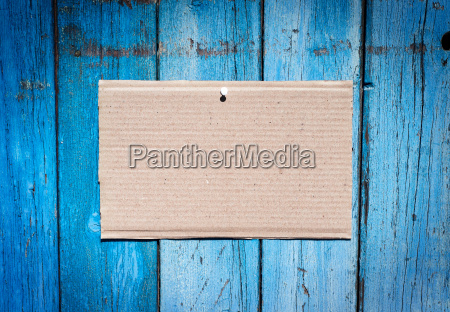 sheet of brown kraft paper hanging