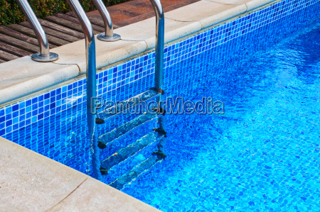 iron staircase in the pool with