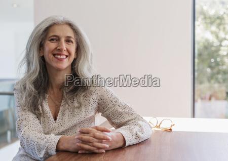 portrait smiling confident mature businesswoman sitting