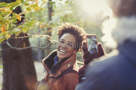 smiling woman posing for boyfriend with