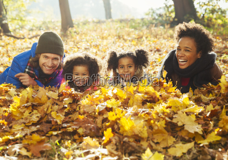 portrait smiling young family laying in