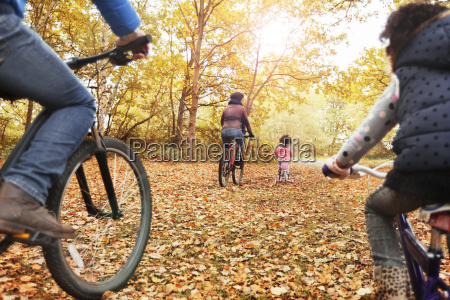 young family bike riding in autumn