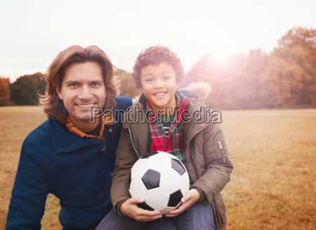 portrait smiling father and son with