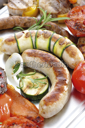 grilled meat sausage and vegetables close