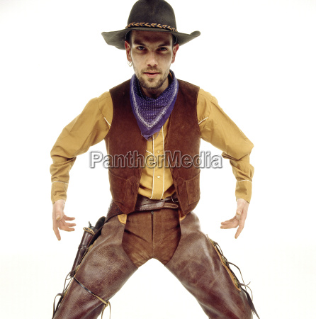 young man dressed as cowboy portrait