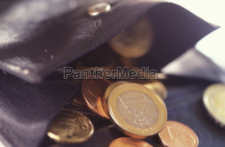 gold coins in wallet close up