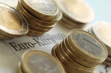 euro coins on business journal