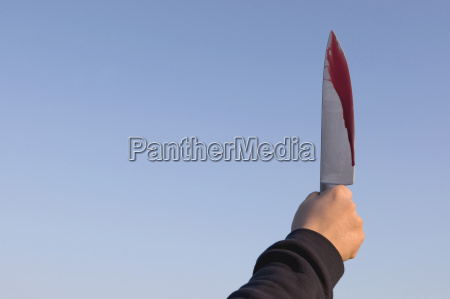 germany person holding knife with blood
