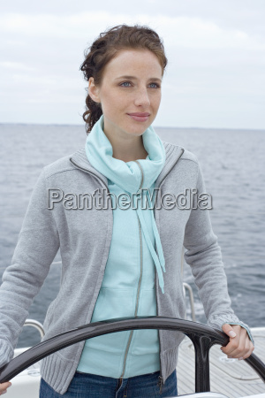 young woman at ships wheel portrait