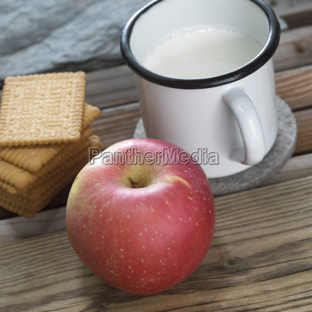 apple biscuits and mug of milk