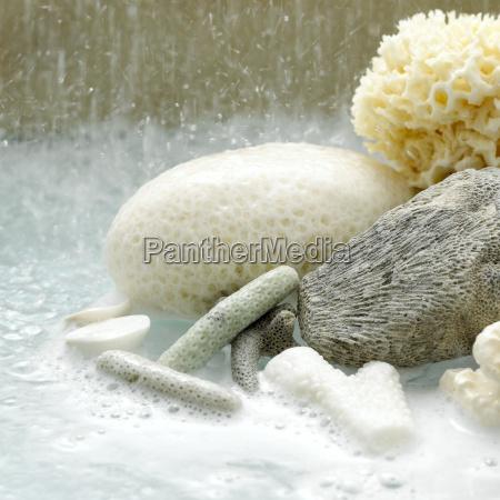 bubble bath with sponges close up
