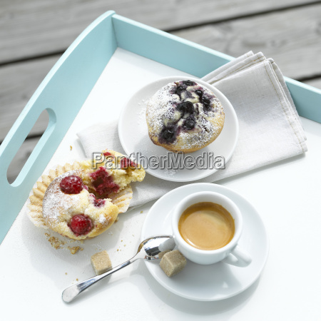 fruit muffins and a cup coffee