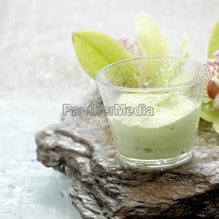 avocado dip in glass close up